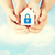 hands holding paper house with lock stock photo © dolgachov