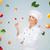 smiling female chef with fork and tomato stock photo © dolgachov