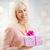smiling woman with gift box over holidays lights stock photo © dolgachov