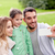 happy family taking selfie by smartphone outdoors stock photo © dolgachov