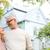 senior couple hugging over living house background stock photo © dolgachov