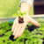 close up of woman hand holding seedling sprout stock photo © dolgachov