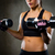 close up of woman flexing arms with dumbbells stock photo © dolgachov
