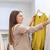 fiatal · nő · választ · póló · ruházat · bolt · gyönyörű · lány - stock fotó © dolgachov