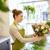 souriant · fleuriste · femme - photo stock © dolgachov