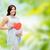 feliz · mulher · grávida · vermelho · coração · tocante · barriga - foto stock © dolgachov