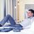 счастливым · деловая · женщина · кровать · номер · в · отеле · бизнеса · технологий - Сток-фото © dolgachov