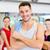 glimlachend · man · permanente · groep · gymnasium · fitness - stockfoto © dolgachov
