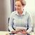 donna · sorridente · giornali · ufficio · uomini · d'affari · business - foto d'archivio © dolgachov