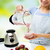 close up of woman with blender and shake at home stock photo © dolgachov