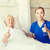 nurse and senior woman showing thumbs up at clinic stock photo © dolgachov