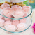 close up of custard sweets on glass serving tray stock photo © dolgachov