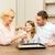 happy family making cookies at home stock photo © dolgachov