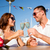 smiling couple drinking champagne at cafe stock photo © dolgachov