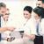 equipe · de · negócios · discutir · algo · escritório · sorridente · negócio - foto stock © dolgachov