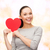 smiling asian woman with red heart stock photo © dolgachov