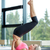 woman doing shoulderstand on mat in gym stock photo © dolgachov