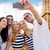 friends taking selfie with smartphone stock photo © dolgachov