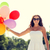 smiling young woman in sunglasses with balloons stock photo © dolgachov
