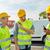 happy male builders in vests with walkie talkie stock photo © dolgachov