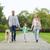 jóvenes · familia · aire · libre · caminando · parque · perro - foto stock © dolgachov