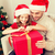 smiling father and daughter opening gift box stock photo © dolgachov