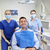 happy female dentists with man patient at clinic stock photo © dolgachov