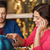 woman with smartphone and friends at restaurant stock photo © dolgachov