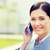 young smiling businesswoman calling on smartphone stock photo © dolgachov