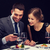 sonriendo · Pareja · comer · restaurante · tecnología - foto stock © dolgachov