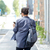 man with backpack and smartphone walking in city stock photo © dolgachov