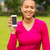 smiling african american woman with smartphone stock photo © dolgachov