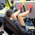 woman flexing muscles on leg press machine in gym stock photo © dolgachov