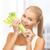 mulher · jovem · alimentação · aipo · mulher · casa · retrato - foto stock © dolgachov