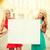 two happy blonde women with blank white board stock photo © dolgachov
