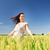 smiling young woman on cereal field stock photo © dolgachov