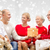 smiling family with gift at home stock photo © dolgachov