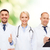 group of doctors showing thumbs up over white stock photo © dolgachov