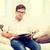 человека · чтение · журнала · молодым · человеком · сидят - Сток-фото © dolgachov