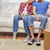 close up of couple relaxing on sofa in new home stock photo © dolgachov