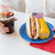 vrouw · eten · mais · hot · dog · cola · amerikaanse - stockfoto © dolgachov