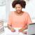 boldog · afroamerikai · nő · laptop · otthon · emberek - stock fotó © dolgachov