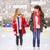 happy girls friends on skating rink stock photo © dolgachov