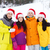 happy friends in santa hats and ski suits outdoors stock photo © dolgachov