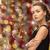 beautiful woman wearing earrings over lights stock photo © dolgachov
