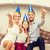smiling family in blue hats with cake stock photo © dolgachov
