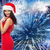 woman in santa hat and red dress over firework stock photo © dolgachov