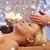 close up of woman having face massage in spa salon stock photo © dolgachov