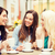 beautiful girls drinking coffee in cafe stock photo © dolgachov