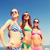 gruppo · sorridere · giovani · donne · spiaggia · vacanze - foto d'archivio © dolgachov